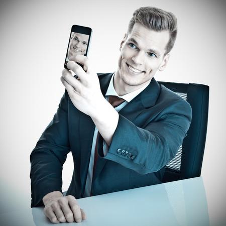 Businessman taking a selfie photo
