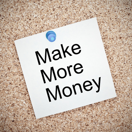 Make More Money , note paper pinned on a cork board photo