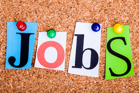 job opportunity: The word Jobs in cut out magazine letters pinned to a cork notice board