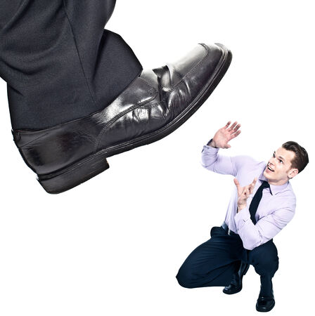 Businessmans foot stepping on tiny businessman - unequal competition concept photo