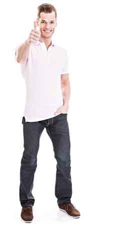 Handsome young man showing thumb up isolated photo