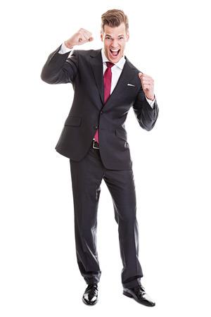 Businessman winning - raised fists