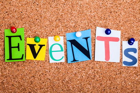 The word Events in cut out magazine letters pinned to a cork notice board Foto de archivo