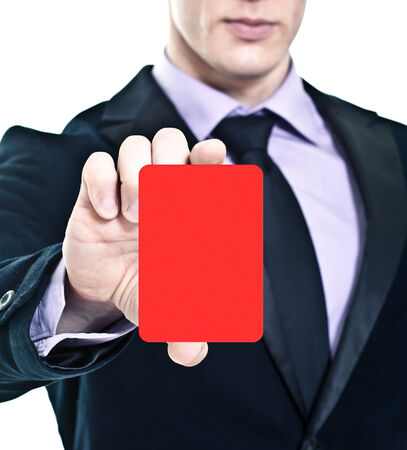 Businessman showing red card photo