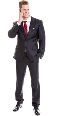 Businessman talking on cell phone photo