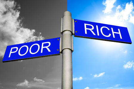 Street signs showing the directions to POOR and RICH