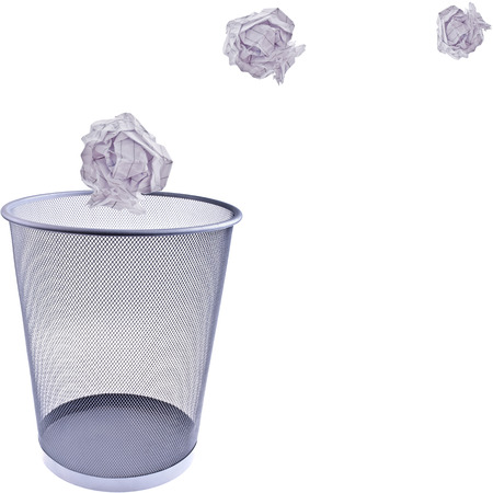Tossing Paper into a wastebasket, completely isolated on white