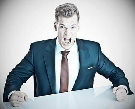 expressing negativity: Anger management - young businessman expressing negativity