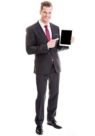 businessman pointing at tablet PC Banco de Imagens