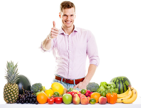 vegetable carbon: Fit man with healthy food - vegetables and fruits isolated on white background Stock Photo