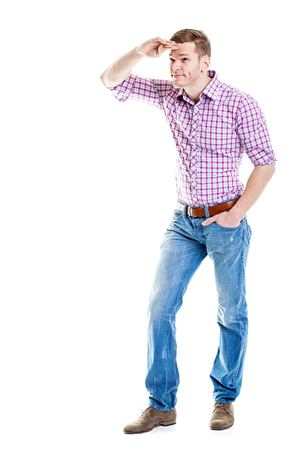 Job Search - Full body shot of young man looking for jobs isolated on white Stock Photo