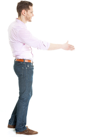 from side: Side view of man offering hand for hand shake - isolated on white