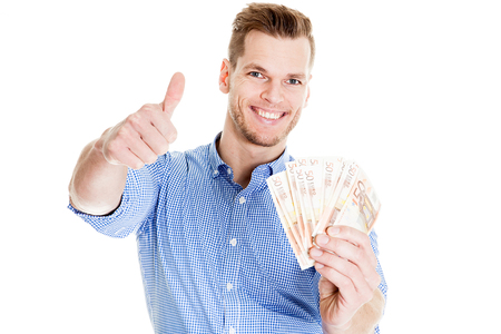 Man holding 50 euro currency and showing thumbs up Standard-Bild