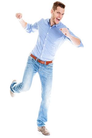 Angry young man smashing something - isolated on white background