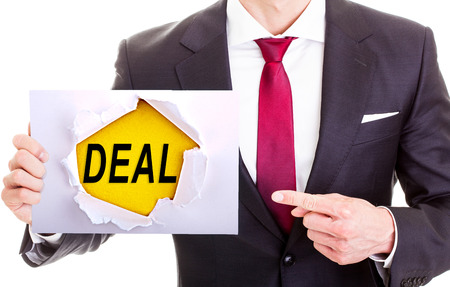 Business man pointing on a card showing need a job - isolated on white