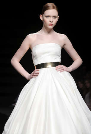 BARCELONA - MAY 10: A model walks on the Rosa Clara catwalk during the Barcelona Bridal Week runway on May 10, 2011 in Barcelona.