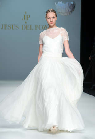 BARCELONA - MAY 11: A model walks on the Jesus del Pozo catwalk during the Barcelona Bridal Week runway on May 11, 2011 in Barcelona.