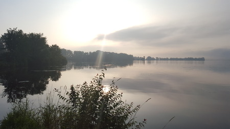 Sun Cutting Through Overcast Cloud/Sky Over Lake at Dawn