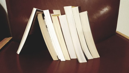 Stack of Books Leaning on a Singe Book Stockfoto