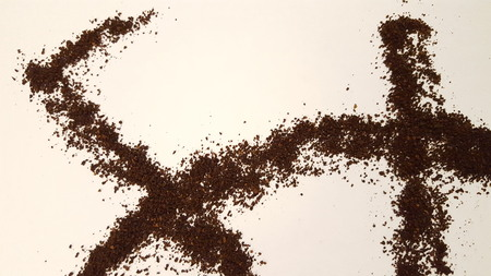 Ground Coffee Artistically Laid Out on White Background
