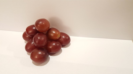 Red Grapes Stacked Up Into a Pyramid