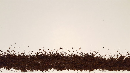 Ground Coffee Laid Out on White Background