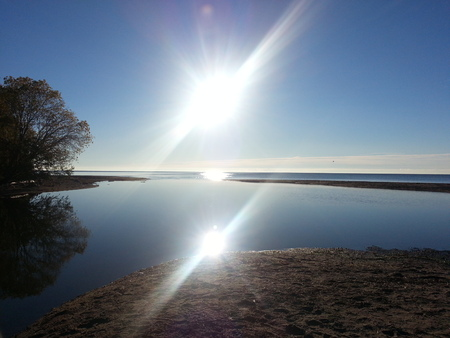 Sun Shining and Reflecting Over Lake in North America/Canada