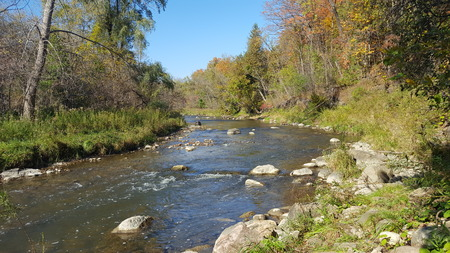Autumn River Flowing in North America/Canada 写真素材