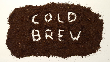 Cold Brew Spelled Out in Ground Coffee on White Background.  Cold Brew Coffee. 写真素材