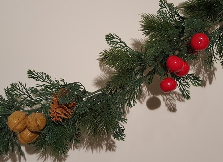Green Merry Christmas Garland With Nature Ornaments.  Happy Holidays and Season's Greetings Greenery Decoration.
