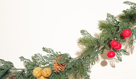 Merry Christmas Garland With Nature Ornaments.  Happy Holidays and Season's Greetings Greenery Decoration.