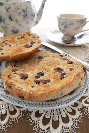 teacake: Toasted Teacakes a traditional British cake of raisins, sultanas and spices in a bun Stock Photo