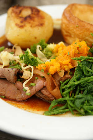 roast potatoes: Roast beef dinner with roast potatoes, Yorkshire pudding and vegetables mashed swede and samphire