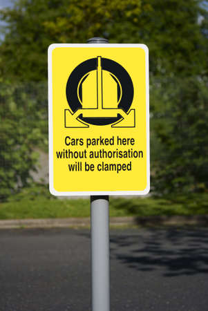 Wheel clamping sign in English Stock Photo - 20957101