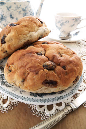 teacake: Toasted Teacakes a traditional British cake of raisins, sultanas and spices in a bun Often eaten as a snack with afternoon tea