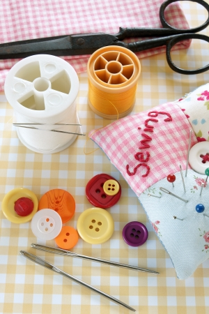 Sewing items including antique scissors, thread, textiles, pins and needles and buttons