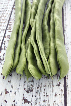 Green String Beans on  a white washed rustic table photo