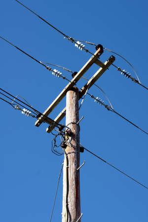 Electricity power line against a blue sky photo