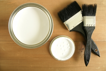 Painting and decorating  Top down view of a pot of white paint and brushes photo