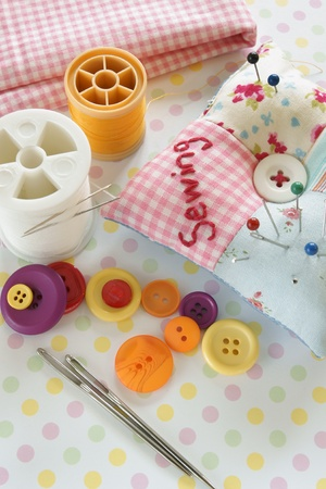 Needles and threads with a pin cushion photo