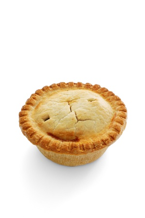 A savoury meat pie with shortcrust pastry studio isolated
