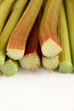 rheum: Freshly cut Rhubarb stems on  a whitewash table