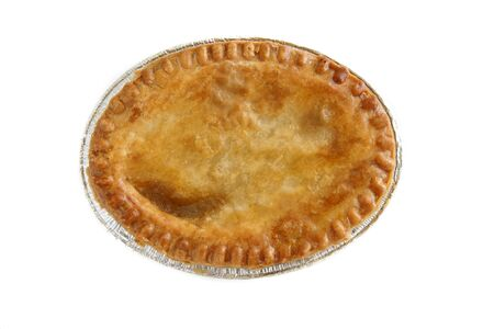 A pie with a golden egg washed crust top down view studio isolated