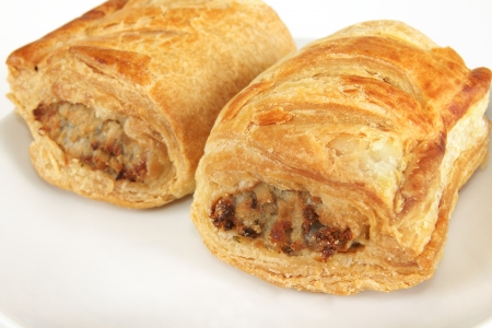 meat pie: Pork sausage rolls on a plate