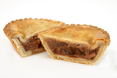 Savoury meat pie with a beef filling studio isolated photo