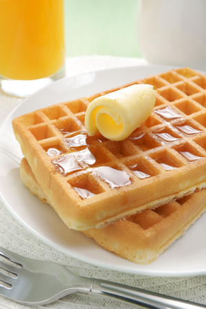 Maple syrup on a stack of waffles
