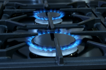 Two gas fueled rings on a domestic cooker or stove photo