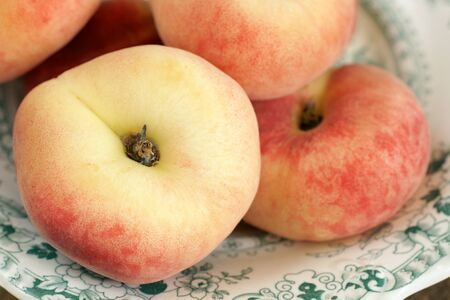 peen: Donut Peaches also known as Saturn peaches on a antique plate. They are also known as paraguayo peach, pan tao peach, saucer peach, belly-up peach, UFO peach or hat peach.