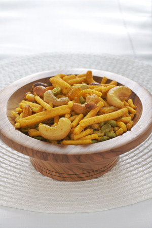 A spicy Indian snack of noodles nuts and peas called Bombay mix in the UK Imagens
