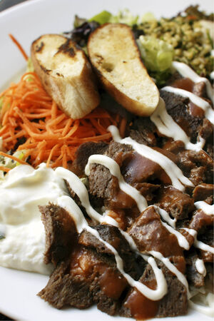 turkish bread: Iskender kebab a popular Turkish dish of lamb served with Turkish bread, rice, vegetables and yoghurt